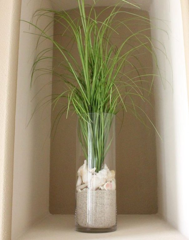 Vase Filled with Sand Shells and Grass