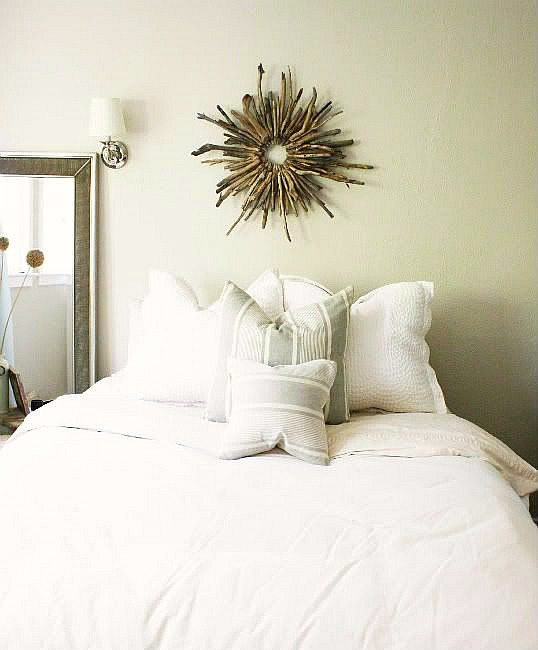 Driftwood Sunburst Wreath above Bed