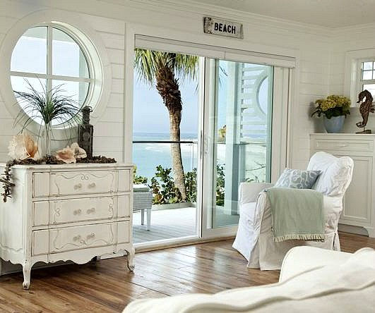 Pure white decor in a remodeled vintage beach cottage on for Classic beach house designs
