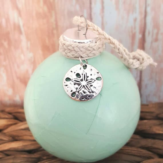 another super cute ornament i love the color of this one along with the silver sand dollar and the rope at the top will look great on any tree