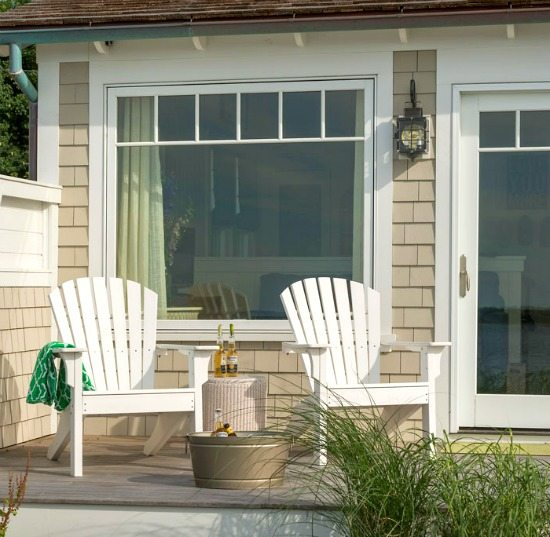 Beach Bungalow Patio with White Adirondack Chairs