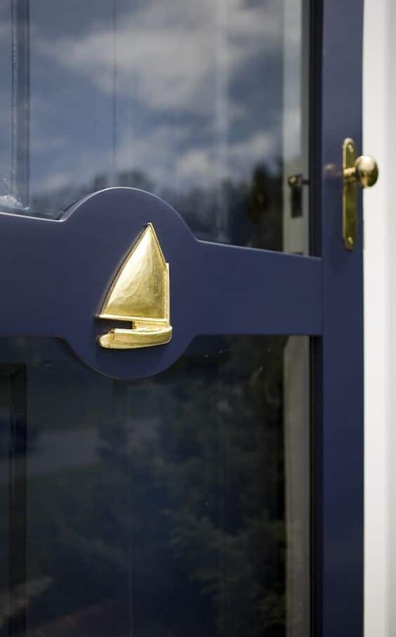 deep blue and gold boat on storm door