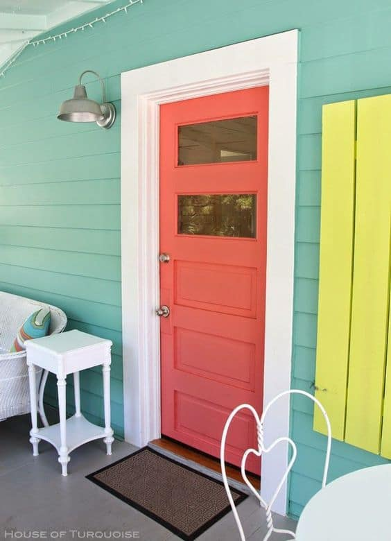 orange door with two glass panels & 13 Front Doors that Will Make Your Beach House Stand Out - Beach ...