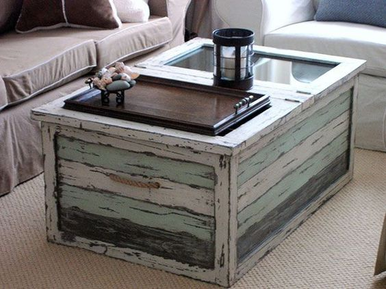 coffee table with glass section and sea green trim